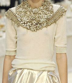 Ivory sweater with marvelous embellishments.