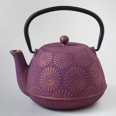 Plum Flower Cast Iron Teapot | World Market Ok, I probably couldn't even lift it, I prefer ice tea, it's just for brewing...but look at it! It's PURPLE! Something about the shape...oh yeah, I want it!