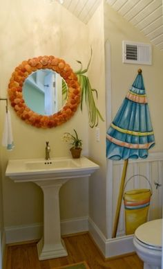 love this shell mirror for the girl's mermaid bathroom