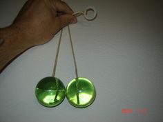 Clackers, or we called them clickety clacks.  You were good if you could make them click on the top and the bottom.