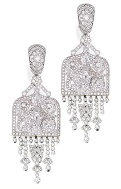 PAIR OF 18 KARAT WHITE GOLD AND DIAMOND PENDANT-EARRINGS Of Art Deco inspiration, the openwork pendants suspending fringes set with numerous round diamonds weighing approximately 8.50 carats.