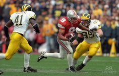 Ohio State Buckeyes receiver David Boston (9) runs after a catch against the Michigan Wolverines at Ohio Stadium.
