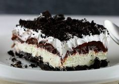 """Sinfully Simple Oreo Delight - Love Oreo cookies?  Here's a must-make easy dessert recipe for you!  With Cool Whip, chocolate pudding and cream cheese, you can make this luscious, layered dreamy treat that's too good to pass up.  All we have to say is """"yum!"""""""