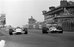 Jacky Ickx (Brabham) passes Jackie Stewart (Matra) on his way to victory at the Grand Prix 1969