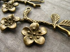 Bronze Flower Charms Plum Blossoms Antiqued by AliCsSupplyShop, $2.65