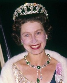 HM Queen Elizabeth II One of Queen Mary's Cambridge emeralds was matched by Garrards, who also supplied the 22 brilliant-cut diamonds