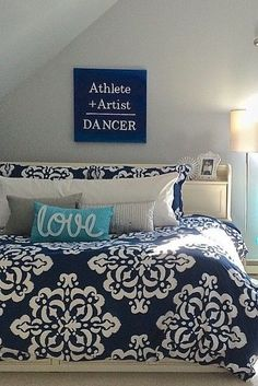 Teen bedroom makeover in blue hues! Layers of pillows and pops of different blues make it a mature and fun space to dream up her future.