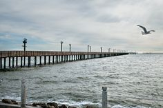 The Sylvan Beach pier in La Porte offers a 1,234-foot-long platform for fishing, wavewatching and languid walks over West Galveston Bay. (Photo by Jake Meharg) http://www.texashighways.com/index.php/component/content/article/48-gulf-coast/6449-bayside-bliss#