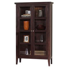 Two-door curio cabinet in dark brown with glass panels and four interior shelves.   Product: China cabinetConstruction Material: Wood composites, select hardwoods and glassColor: Dark brown Features:  Two cabinet doorsThree interior shelves    Dimensions: 66 H x 38 W x 18.5 D  Note: Assembly required. Hardware included. Cleaning and Care: Dust with clean, soft damp cloth