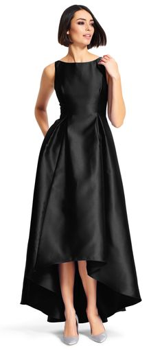 Cut in a high low silhouette, this elegant Mikado gown features a fit and flare style and pockets at either side. This long dress also has a v-back, gentle pleating to create a full skirt, and a high neckline. Simple and glamorous, this formal dress will be a memorable part of any evening out.
