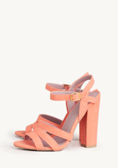 Strappy peach sandals that can easily transition into fall with army green pants and a white tee