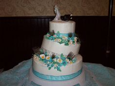 Pecock and lilly wedding cake