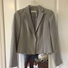 "Calvin Klein Blazer This is a lighter gray one button blazer that can be worn all year round. The length is on the shorter side (21"" from should to front bottom). Perfect for the office or throw it on with your favorite jeans for a night out. In great condition! Calvin Klein Jackets & Coats Blazers"