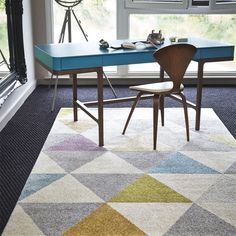 In interior design, contrast can be cool. When it comes to finding a rug, play with patterns!