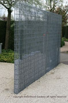 Some innovative ideas on display at Appeltern Gardens, such as this hardware cloth metal mesh gabion-like fence, or perhaps it's a wall, partially filled with trap rock. -- BelleWood-Gardens - Diary