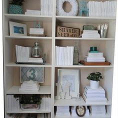 Book Shelf Organization/White bookcovers  accessories in one accent color--do it! Also bookpages rolled up for letter cover
