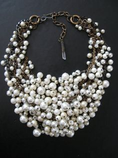 """SavageSalvage: $178 """"Mermaid Farts - Tangled Decayed Upcycled Pearl Bib Necklace"""" Cream ecru (Faux) pearls on a treated brass chain with crystal bullet accent at clasp."""