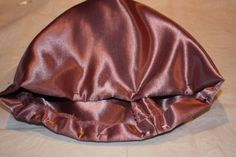 The poke bonnet was fashionable at the beginning of the 19th century, and consisted of a small crown and wide brim to shade the face. From 1830 through to the 1840s, the shape of the brim became mo…