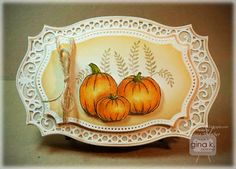 handmade card from Crafting The Web ... Autumn theme ... shaped card using layers of Spellbinders die templates ... Copic coloring ... pumpkins ... lacey die cut frame ... gorgeous ... Gink K Designs ...