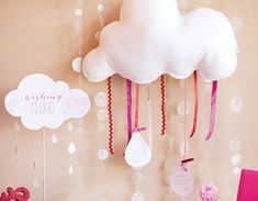 Wishing Cloud: guests write well-wishes for mom and baby on raindrop shaped notecards then use mini clothespins to attach the messages to ribbons hanging from a felt or paper cloud