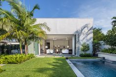Indoor/outdoor living is what it's all about in the heart of Key West. This  modern, tropical garden landscape design in the heart of Key West. The architecture was done by Haven Burkee of Bender & Associates Architecture and the landscape was designed to reflect the contemporary architecture from the concrete pavers, to the minimalist grouping of the tropical plants and let's not forget the swimming pool that's framed by groupings of bromeliads.