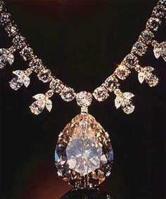 The Victoria-Transvaal is a 67.89-carat, champagne-colored, pear shaped stone.  The necklace was designed by Baumgold Brothers, Inc, & consists of a yellow gold chain w/ 66 round brilliant-cut diamonds, fringed w/ ten drop motifs, each set w/ two marquise-cut diamonds, a pear-shaped diamond, & a small round brilliant-cut diamond (total weight of the 106 diamonds is about 45 carats). The necklace was donated by Leonard & Victoria Wilkinson in 1977 to the Smithsonian Institute, Washington D.C.