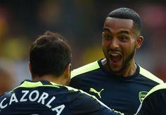 Santi Cazorla celebrates scoring the first goal with Theo Walcott