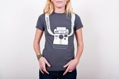 The Photojojo Camera Strap Tee     Strapping tees to keep your favorite cameras close by.