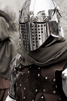 Liking the helmet - the shape of a 13th century great helm but with a hinged visor of early Renaiassance varients..