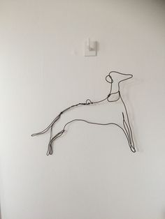Greyhound dog artwork. Dog art line drawing style. Handmade from aluminium wire. Hangs on a tiny piece of plastic wire which is invisible from a distance. Home decor and interior design ideas.       Available for sale in my Etsy shop AHWDesign. Click on this link to see my shop.  animal artwork/animal artists.