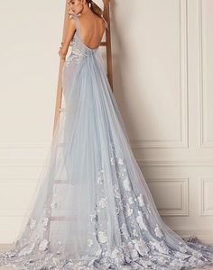 A lot of the pieces in our FW 15/16 collection have been inspired by the ice queen in Disney's frozen. She wears beautiful dresses in pale blue, and I wanted to create my own take on the dresses and bring them to life. This piece is a heavily embroidered tulle piece with a train that start from the back & fall downs with floral appliqué #HamdaAlFahim