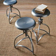 Unmatched industrial stools serve double duty as side tables and easily moveable seating throughout.     Metal Industrial Stool   WestElm $149