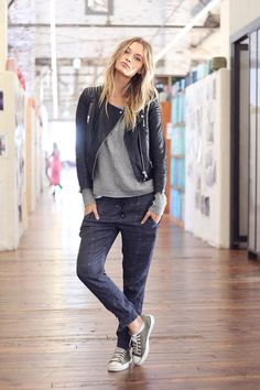 Grey top, leather jacket and baggy pants