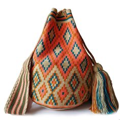 $114.00 USD Traditional single-thread large mochila bags are one of the most iconic crafts in Colombia. Each piece has taken over 20 days to make and is sure to last you throughout the years. Make it your go to bag for this summer. It's hard to have just one! Tapestry Bag, Tapestry Crochet, Mochila Crochet, Tribal Patterns, Unique Bags, Knitted Bags, Filet Crochet, Beautiful Bags, Fashion Bags