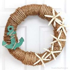An anchor detail and seashell garland transform this rope-covered wreath into a coastal creation.Get... - Courtesy of How to Nest for Less