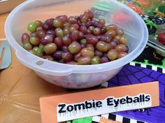 """Sometimes that's all you need is a sign! There's nothing special about these grapes, but the """"Zombie Eyeballs"""" sign makes them seem disgusting! Perfect for a Halloween party table."""