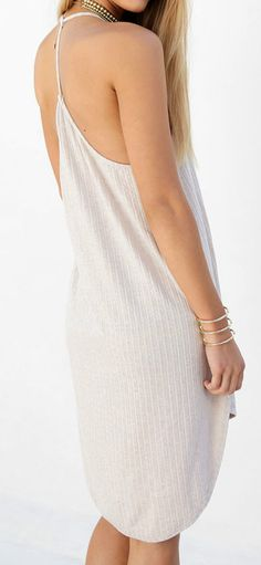 Wanna a sunshine holiday? Try this dress detailed with solid color, lace-up front, spaghetti strap, backless design and asymmetric hem.