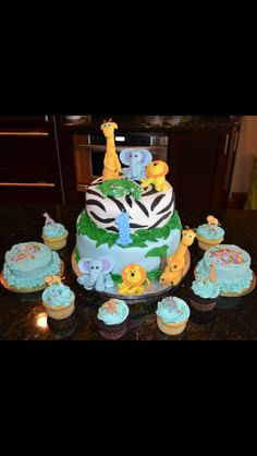 Zoo cake with cupcakes and smash cakes for first birthdays