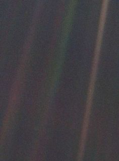 The Earth, a pale blue dot, seen from over 6 billion km away by the Voyager 1 spacecraft. From that distance, it was far less than a single pixel wide