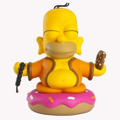 """With a pretzel in one hand, and beads in another, Homer passes down the oral tradition of donut eating. From THE SIMPSONS and Kidrobot comes Homer Buddha in 7-inch vinyl, inspired by THE SIMPSONS episode """"Goo Gai Pan,"""" in which Homer poses as Buddha to gain entry into an orphanage in China. Available beginning September 6 for $50 US (£40.10 UK, €46.50 EU) at Kidrobot stores, kidrobot.com, and select retailers worldwide."""