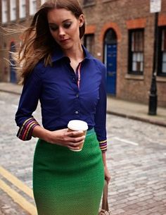 Love the color combination.  Blue button down shirt and green skirt.