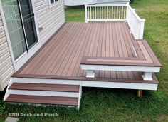 Vinyl patio deck using Wolf PVC Decking with amberwood flooring and rosewood border and Longevity white PVC railing. | Yelp