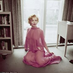 Newly released photos of Marilyn Monroe taken in her apartment in 1952, the personal frames were taken by renowned photographer Philippe Halsman