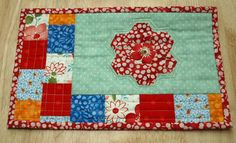 Mug rug with a hexie flower