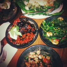 Indonesian food; ayam bakar madu (honey grilled chicken), kangkung udang (water spinach with shrimp), nasi bakar (smoked rice), cumi oseng cabe ijo (stir-fried baby squid with green chilies.