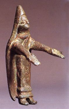 Praying woman with a steep mantilla.  Bronze votive offerings at Castillar  de Santiesteban, 400-100 bce.