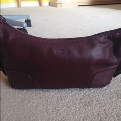 Kenneth Cole Reaction Purse +Free Gift Burgundy Kenneth Cole Reaction leather purse. In excellent condition, has only been used a couple of times. Has compartments on the inside of purse. Make an offer! Kenneth Cole Reaction Bags