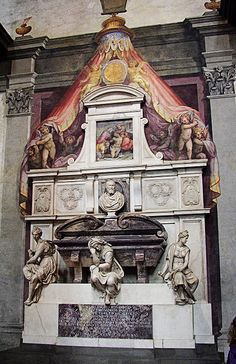 Michelangelo's tomb, Santa Croce, Florence. As you enter Santa Croce immediately to the right is the tomb of Michelangelo. The monument was designed by Vasari in 1570 and the three ladies symbolize Painting, Architecture and sculpture. The great artist wanted to be buried here so that the first thing he would see on Judgment Day would be Brunelleschi's dome through the open doors of Santa Croce.