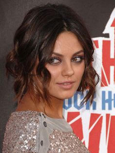 Mila Kunis's Undone Updo  Create beachy curls by wrapping hair in a figure 8 around your iron while holding it vertically. Do a low, loose bun and push out some pieces in the front.