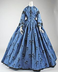 ca. 1863 French, blue silk brocade dress with black trim & buttons.